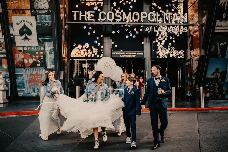 Bride with her bridal party wearing personalised denim jackets for Las Vegas wedding