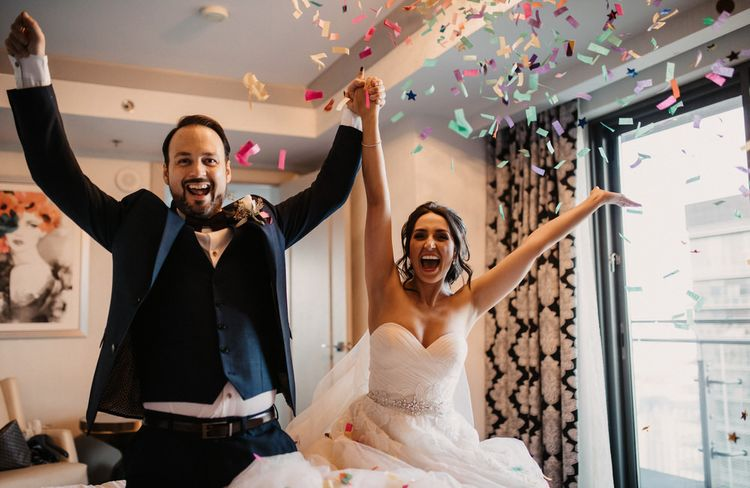 Bride and groom re-create their confetti moment back in the room