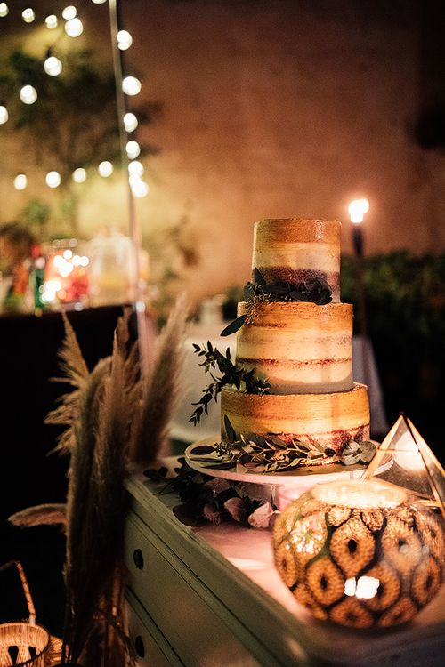 Rustic wedding cake at celebration with Moroccan themed wedding decor