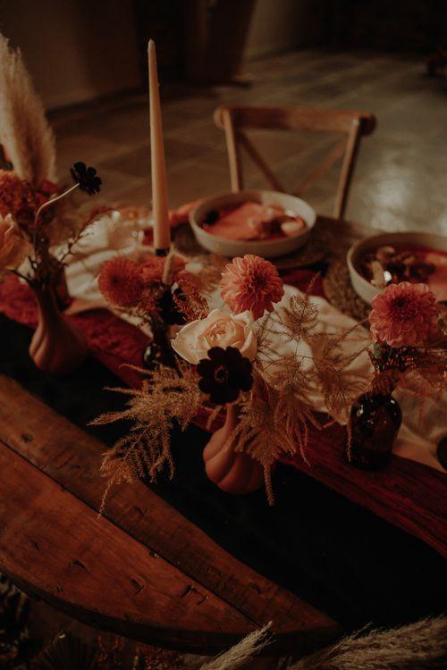 Orange dahlias and wedding flower decor