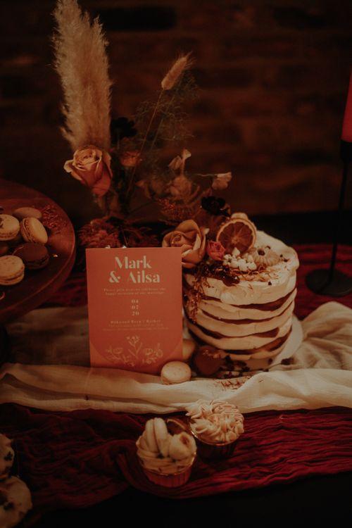 Meringue tower wedding cake and orange wedding sign