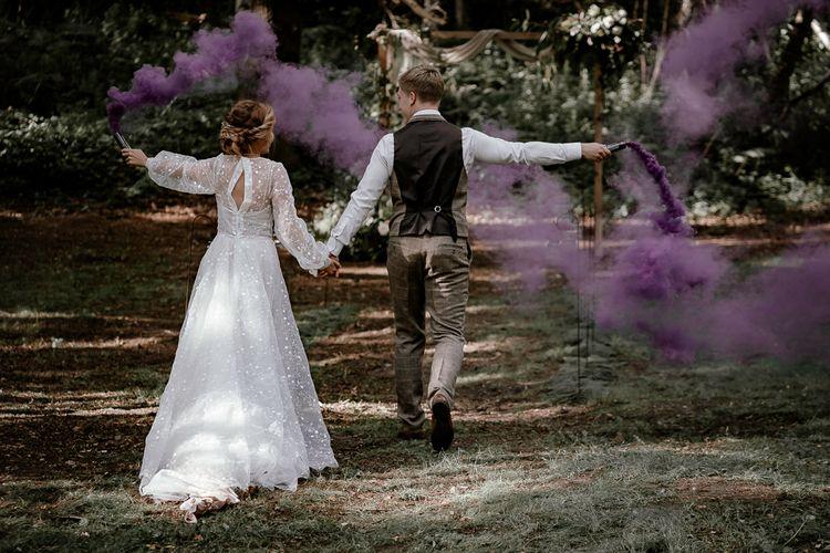 Purple smoke bombs at Sherwood Glade woodland wedding