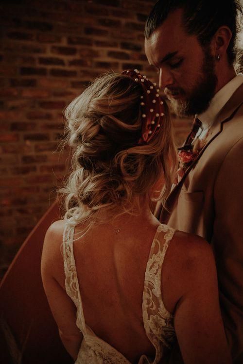 Bride in orange headband with pearls