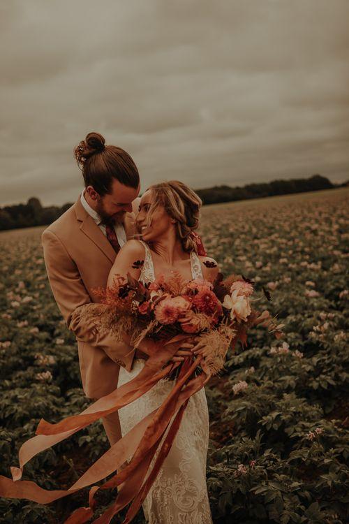 Intimate wedding with orange wedding theme