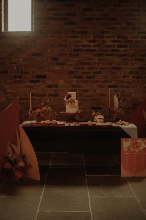 Wedding dessert table with semi naked wedding cake and doughnuts