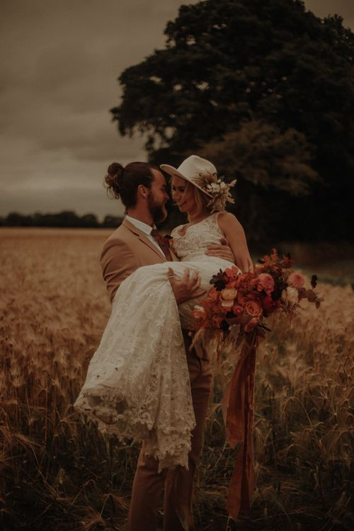 Boho bride and groom portrait in a field by Esme Whiteside Photography