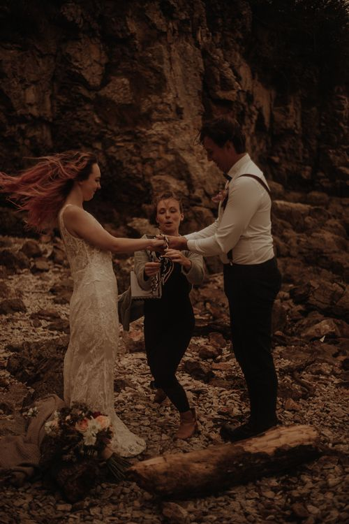 Hand fastening at intimate wedding