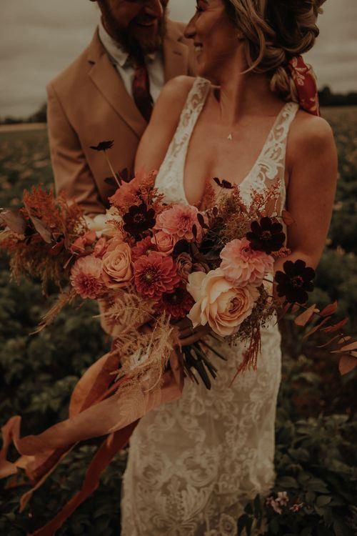 Orange and peach wedding bouquet with dahlias