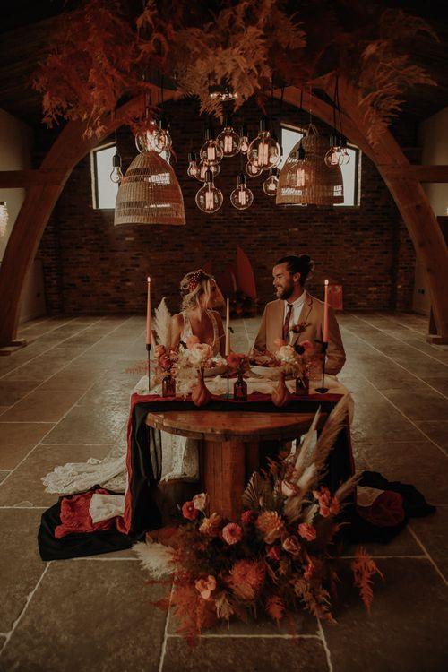 Intimate wedding at Oakwood at Ryther with orange wedding theme