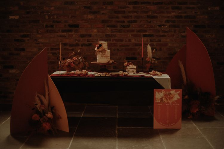 Dessert table and orange wedding stationery sign
