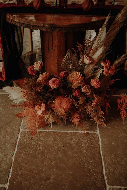 Orange wedding flowers and dried grasses