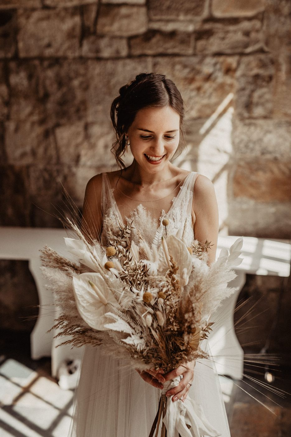 Bride with Dried Flower Wedding Bouquet